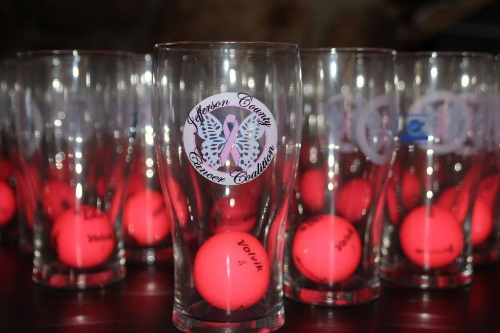Cancer Coalition glasses with golf balls inside