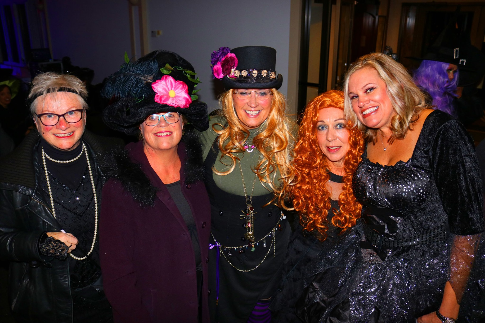 Group picture of witches dressed up